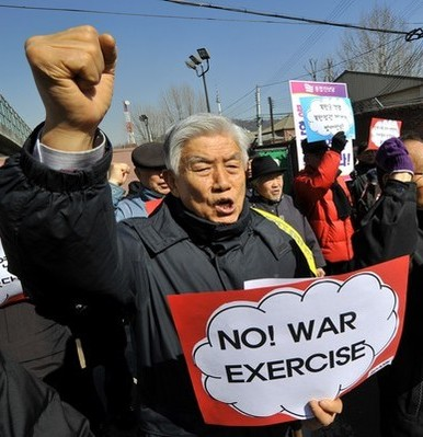 Anti-war activists shout slogans during